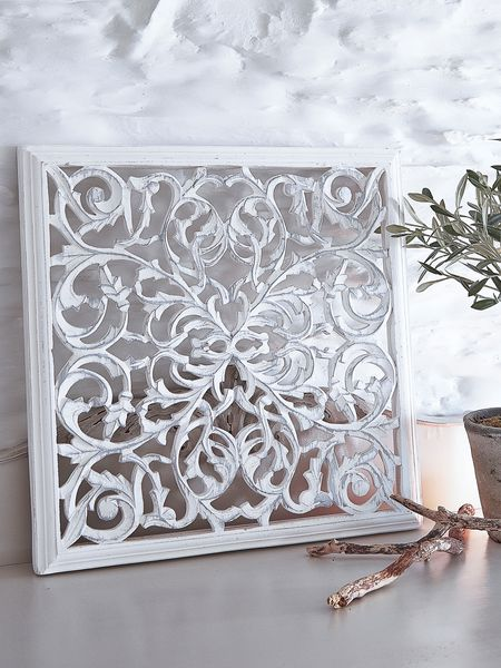 Carved white wooden wall panel square from nordic house