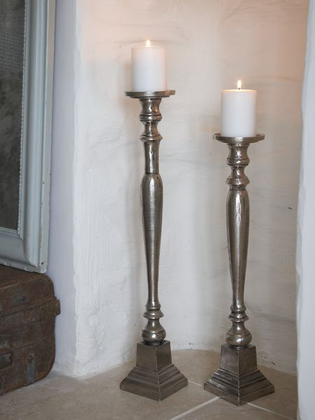Aged metal floor candle holders for Floor candle holders
